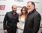 Actors Jason Statham and Jennifer Lopez pose with Director Taylor Hackford at a screening of 'Parker' hosted by FilmDistrict The Cinema Society...