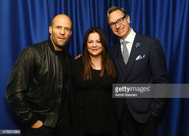 Actors Jason Statham and Melissa McCarthy poses for photos with director Paul Feig during SiriusXM's 'Town Hall' With Melissa McCarthy Jason Statham...