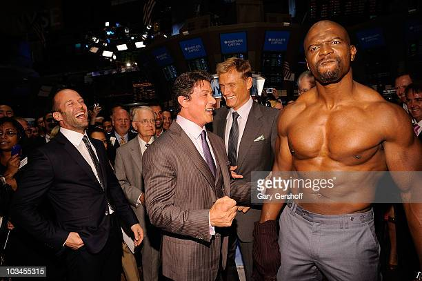 Actors Jason Statham Sylvester Stallone Dolph Lundgren and Terry Crews attend the ringing of the opening bell at the New York Stock Exchange on...
