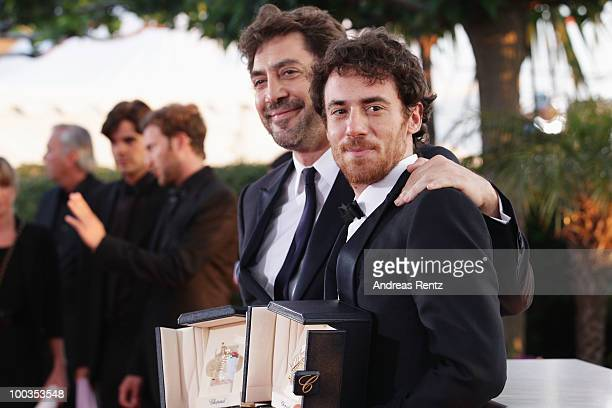 Actors Javier Bardem and Elio Germano pose with their Best Actor awards for during the Palme d'Or Award Ceremony photocall held at the Palais des...