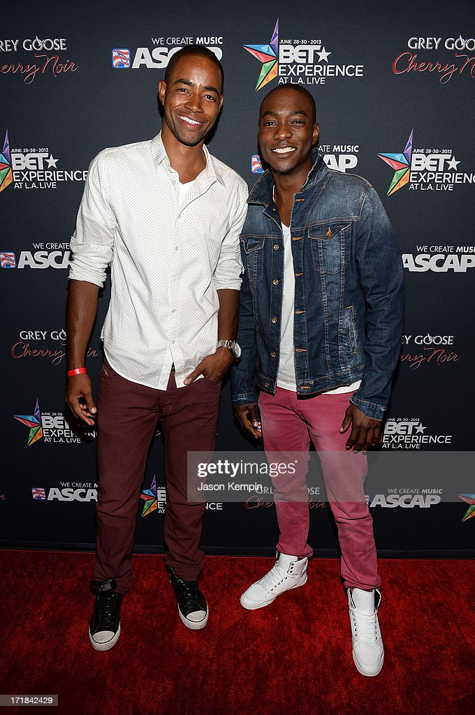 Actors Jay Ellis (L) and B.J. Britt arrive at the Grey Goose Cherry Noir Flavored Vodka VIP after party during the 2013 BET Experience at The Conga Room at L.A. Live on June 28, 2013 in Los Angeles, California.