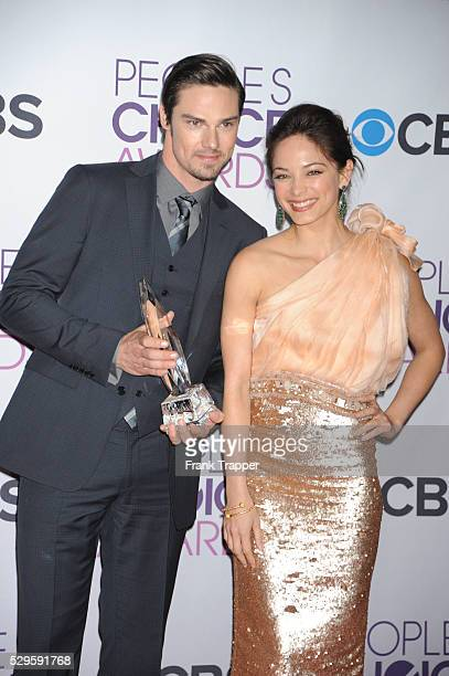 Actors Jay Ryan and Kristin Kreuk poses pose in the press room at the People's Choice Awards 2013 held at the Nokia Theater L A Live