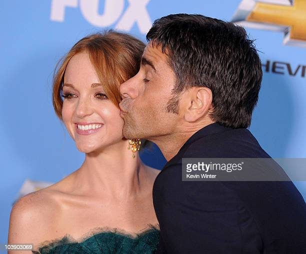 Actors Jayma Mays and John Stamos arrive at the premiere of 20th Century Fox's 'Glee' Season 2 held at Paramount Studios on September 7 2010 in...