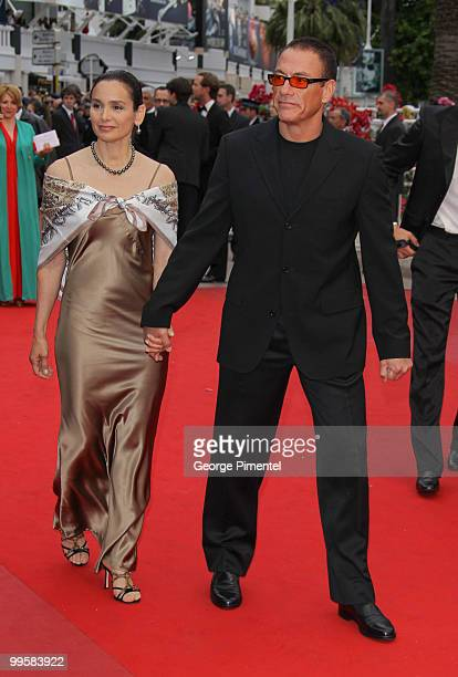 Actors Jean Claude Van Damme and Gladys Portugues attend the 'You Will Meet A Tall Dark Stranger' Premiere held at the Palais des Festivals during...