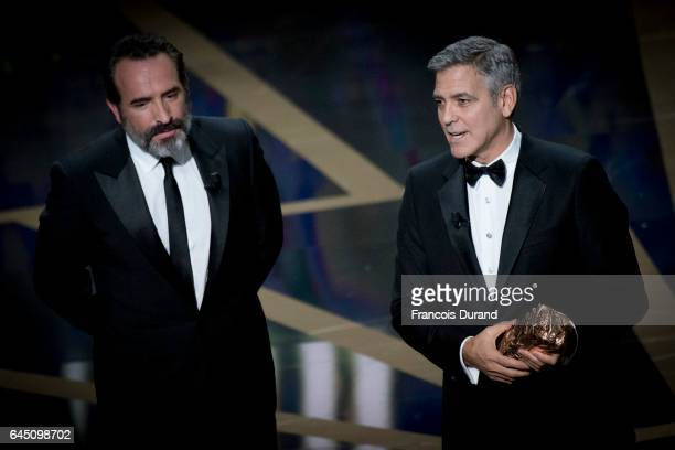 Actors Jean DuJardin and George Clooney on stage during the Cesar Film Awards Ceremony at Salle Pleyel on February 24 2017 in Paris France
