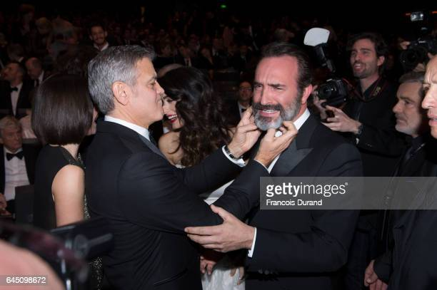 Actors Jean DuJardin and George Clooney prior to the Cesar Film Awards Ceremony at Salle Pleyel on February 24 2017 in Paris France