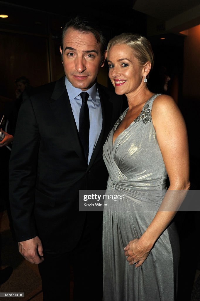 Actors Jean Dujardin and Penelope Ann Miller celebrate 'The Artist' winning Outstanding Directorial Achievement in Feature Film for 2011 at the 64th...
