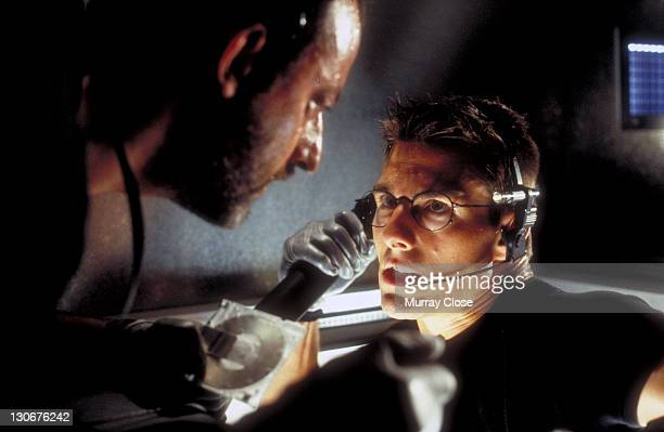 Actors Jean Reno as Franz Krieger and Tom Cruise as Ethan Hunt in a scene from the film 'Mission Impossible' 1996 Here they steal the NOC list from...
