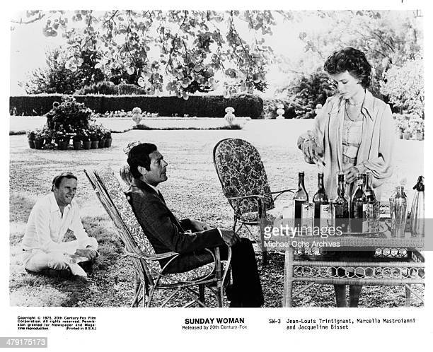 Actors JeanLouis Trintignant Marcello Mastroianni and actress Jacqueline Bisset in a scene from the movie 'The Sunday Woman' circa 1975