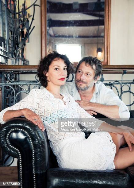 Actors Jeanne Balibar and Mathieu Amalric are photographed for Paris Match on August 28 2017 in Paris France