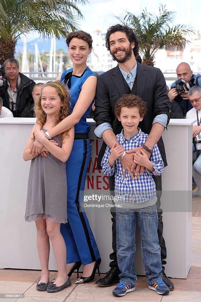 Actors Jeanne Jestin, Berenice Bejo, <a gi-track='captionPersonalityLinkClicked' href=/galleries/search?phrase=Tahar+Rahim&family=editorial&specificpeople=5856944 ng-click='$event.stopPropagation()'>Tahar Rahim</a> and Elyes Aguis attends the photocall for 'Le Passe' (The Past) during the 66th Annual Cannes Film Festival at Palais des Festivals on May 17, 2013 in Cannes, France.