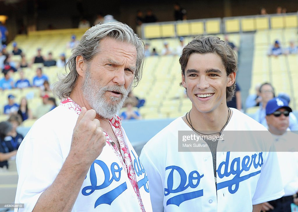 Actors <a gi-track='captionPersonalityLinkClicked' href=/galleries/search?phrase=Jeff+Bridges&family=editorial&specificpeople=201735 ng-click='$event.stopPropagation()'>Jeff Bridges</a> (L) and <a gi-track='captionPersonalityLinkClicked' href=/galleries/search?phrase=Brenton+Thwaites&family=editorial&specificpeople=10008512 ng-click='$event.stopPropagation()'>Brenton Thwaites</a> before the game between the Chicago Cubs and Los Angeles Dodgers at Dodger Stadium on August 1, 2014 in Los Angeles, California.