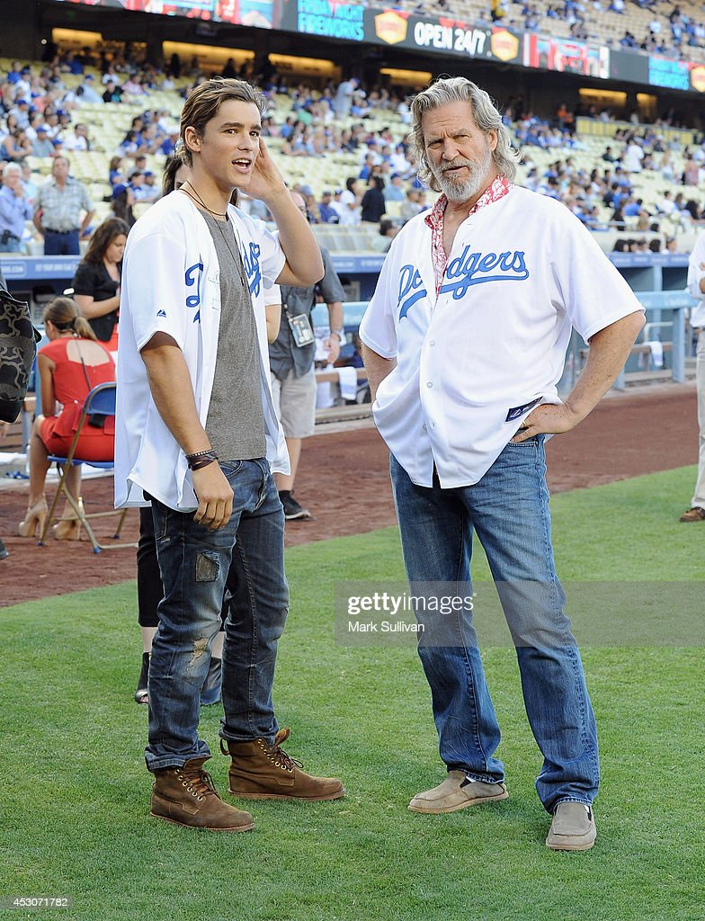 Actors <a gi-track='captionPersonalityLinkClicked' href=/galleries/search?phrase=Jeff+Bridges&family=editorial&specificpeople=201735 ng-click='$event.stopPropagation()'>Jeff Bridges</a> (R) and <a gi-track='captionPersonalityLinkClicked' href=/galleries/search?phrase=Brenton+Thwaites&family=editorial&specificpeople=10008512 ng-click='$event.stopPropagation()'>Brenton Thwaites</a> before the game between the Chicago Cubs and Los Angeles Dodgers at Dodger Stadium on August 1, 2014 in Los Angeles, California.