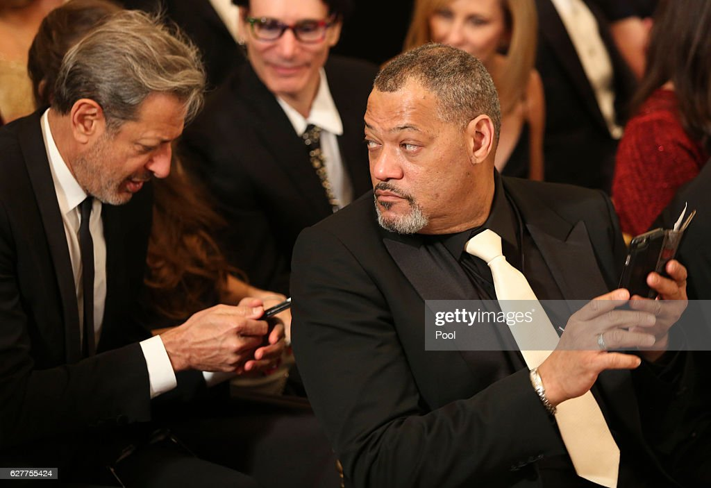 Actors Jeff Goldblum (L) and Laurence Fishburne attend a ceremony for the 2016 Kennedy Center honorees December 4, 2016 in the East Room of the White House in Washington, DC. The honorees include Eagles band members, actor Al Pacino, singer James Taylor, pianist Martha Argerich and singer Mavis Staples.