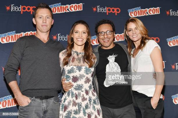 Actors Jeffrey Donovan KaDee Strickland Aasif Mandvi and Susan Misner pose onstage after Hulu's Shut Eye panel at New York Comic Con at Jacob Javits...