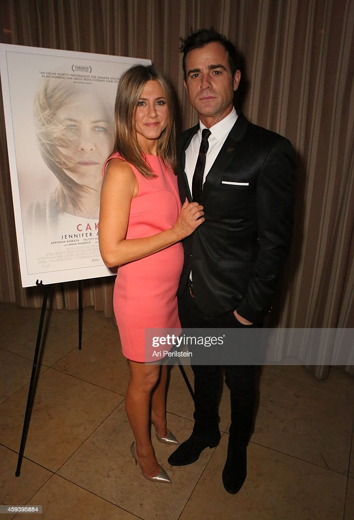 Actors Jennifer Aniston and Justin Theroux attend a cocktail party with Jennifer Aniston following a special screening of CAKE at Sunset Tower on...