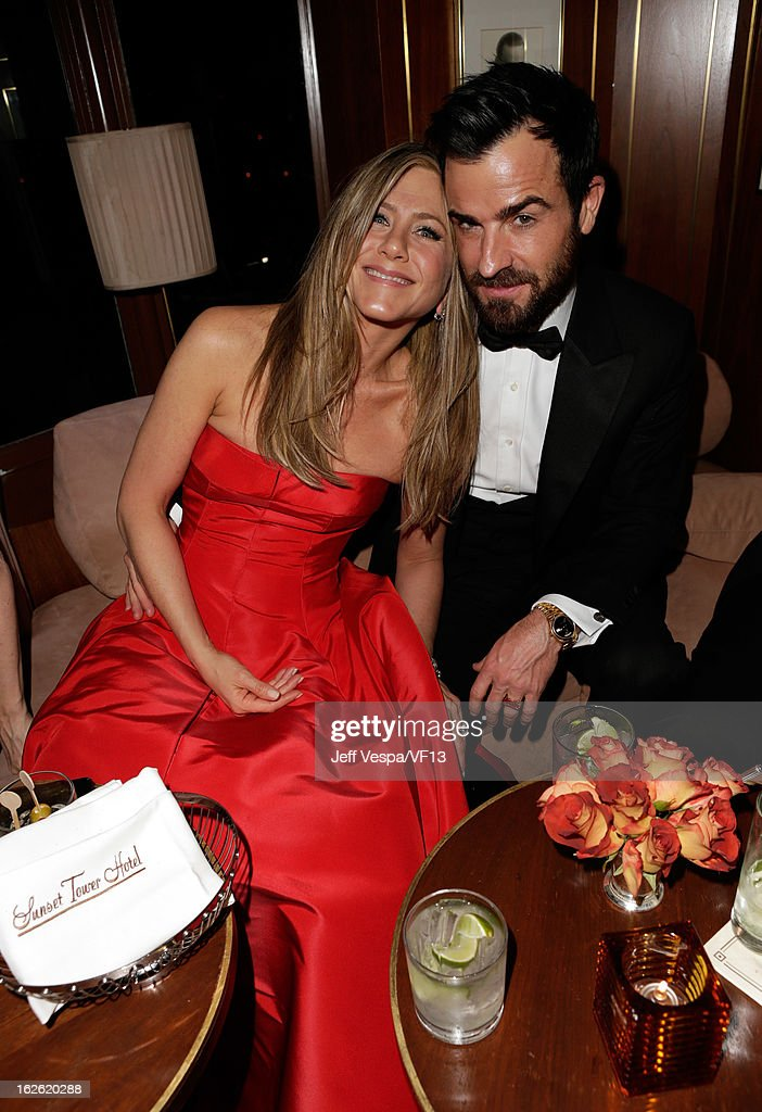 Actors Jennifer Aniston and Justin Theroux attend the 2013 Vanity Fair Oscar Party hosted by Graydon Carter at Sunset Tower on February 24 2013 in...