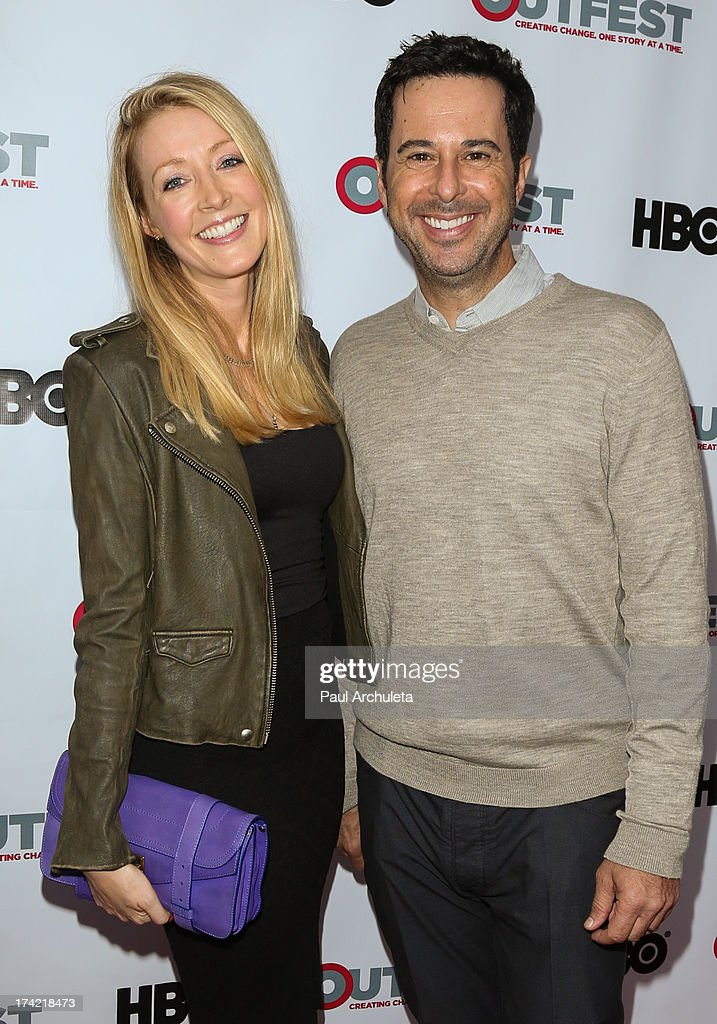 Actors Jennifer Finnigan (L) and Jonathan Silverman (R) attend the screening of 'G.B.F.' at the 2013 Outfest film festival closing night gala at the Ford Theatre on July 21, 2013 in Hollywood, California.