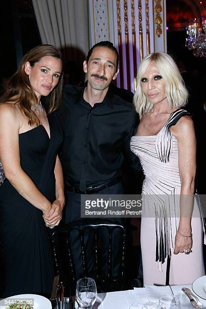 Actors Jennifer Garner Adrien Brody and Donatella Versace attend the Amfar Paris Dinner Stars gather for Amfar during the Haute Couture Week Held at...