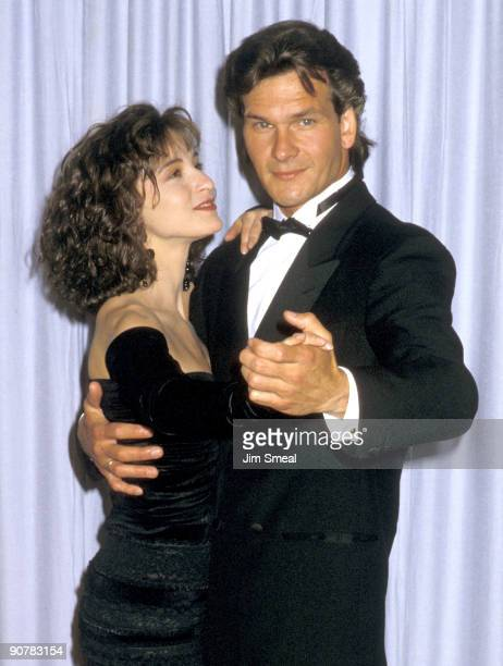 Actors Jennifer Grey and Patrick Swayze attend the 60th Annual Academy Awards at the Shrine Auditorium on April 11 1988 in Los Angeles California