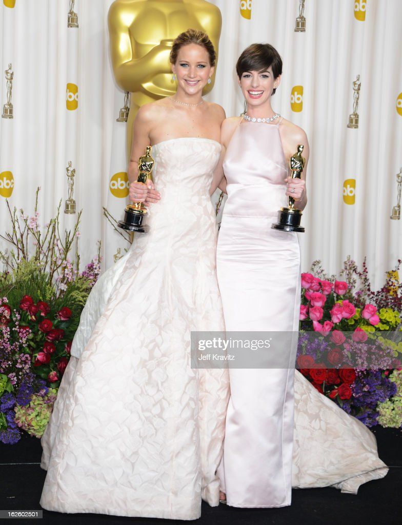 Actors <a gi-track='captionPersonalityLinkClicked' href=/galleries/search?phrase=Jennifer+Lawrence&family=editorial&specificpeople=1596040 ng-click='$event.stopPropagation()'>Jennifer Lawrence</a> (L) and <a gi-track='captionPersonalityLinkClicked' href=/galleries/search?phrase=Anne+Hathaway+-+Actress&family=editorial&specificpeople=11647173 ng-click='$event.stopPropagation()'>Anne Hathaway</a> pose in the press room during the Oscars at Loews Hollywood Hotel on February 24, 2013 in Hollywood, California.