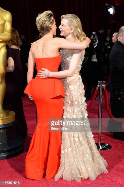 Actors Jennifer Lawrence and Cate Blanchett attend the Oscars held at Hollywood Highland Center on March 2 2014 in Hollywood California