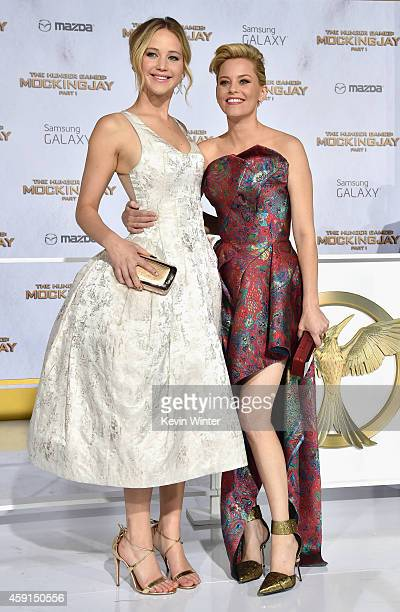 Actors Jennifer Lawrence and Elizabeth Banks attend the premiere of Lionsgate's 'The Hunger Games Mockingjay Part 1' at Nokia Theatre LA Live on...