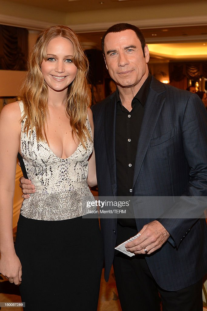 Actors Jennifer Lawrence and John Travolta attend the Hollywood Foreign Press Association's 2012 Installation Luncheon held at the Beverly Hills Hotel on August 9, 2012 in Beverly Hills, California.