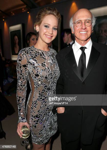Actors Jennifer Lawrence and Larry David attend the 2014 Vanity Fair Oscar Party Hosted By Graydon Carter on March 2 2014 in West Hollywood California