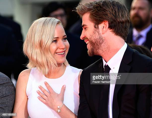 Actors Jennifer Lawrence and Liam Hemsworth attend Lionsgate's 'The Hunger Games Mockingjay Part 2' Hand and Footprint Ceremony at TCL Chinese...