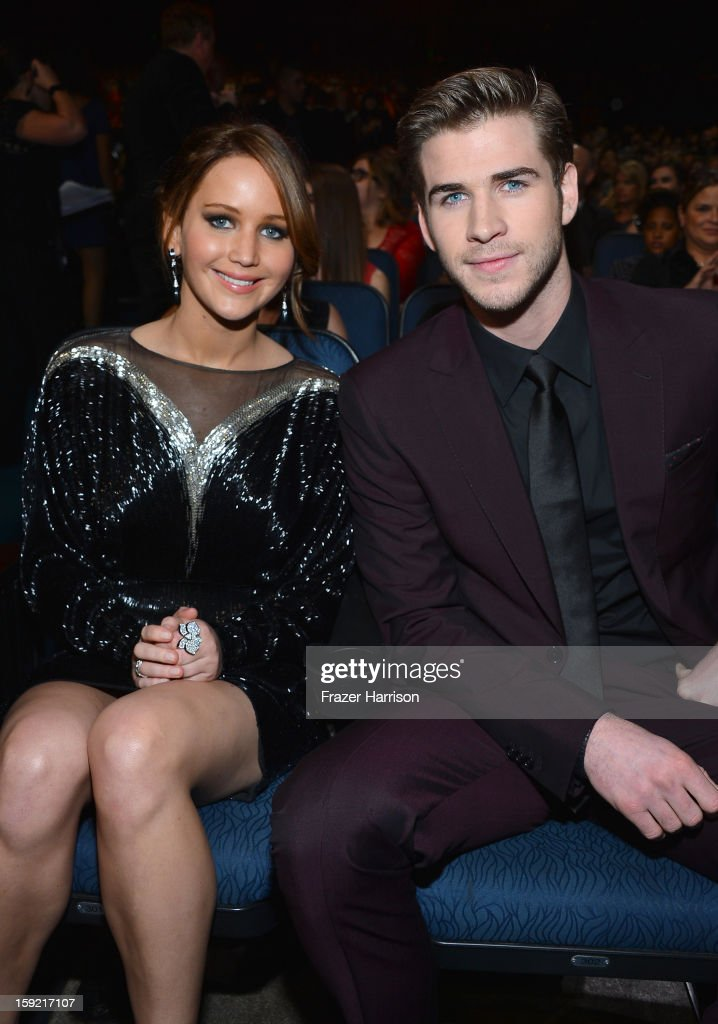 Actors <a gi-track='captionPersonalityLinkClicked' href=/galleries/search?phrase=Jennifer+Lawrence&family=editorial&specificpeople=1596040 ng-click='$event.stopPropagation()'>Jennifer Lawrence</a> (L) and <a gi-track='captionPersonalityLinkClicked' href=/galleries/search?phrase=Liam+Hemsworth&family=editorial&specificpeople=6338547 ng-click='$event.stopPropagation()'>Liam Hemsworth</a> attend the 39th Annual People's Choice Awards at Nokia Theatre L.A. Live on January 9, 2013 in Los Angeles, California.
