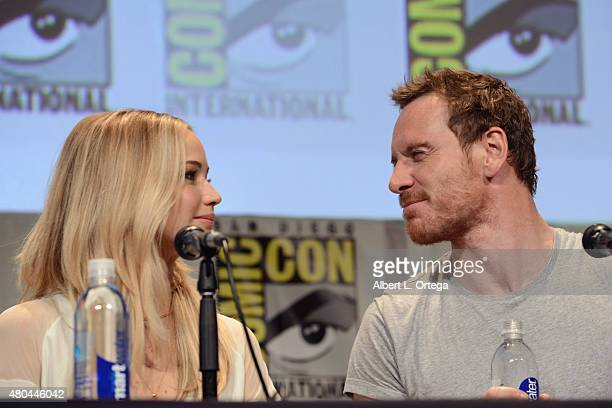 Actors Jennifer Lawrence and Michael Fassbender of 'XMen Apocalypse' speak onstage at the 20th Century FOX panel during ComicCon International 2015...