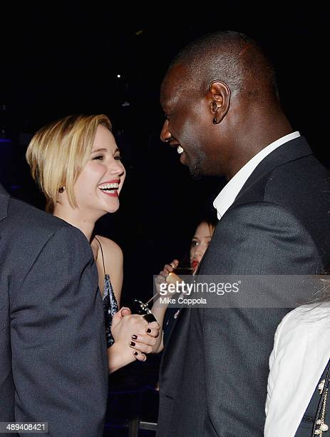 Actors Jennifer Lawrence and Omar Sy attend the 'XMen Days Of Future Past' after party at SIR Stage37 on May 10 2014 in New York City