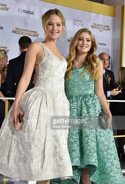 Actors Jennifer Lawrence and Willow Shields attend the premiere of Lionsgate's 'The Hunger Games Mockingjay Part 1' at Nokia Theatre LA Live on...