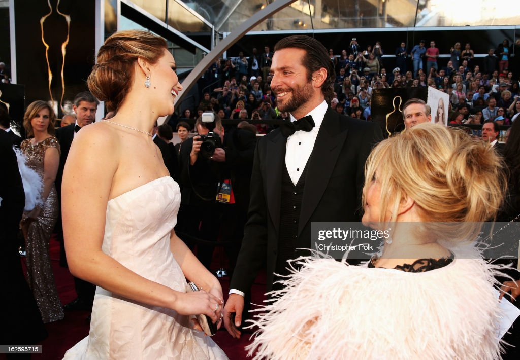 Actors <a gi-track='captionPersonalityLinkClicked' href=/galleries/search?phrase=Jennifer+Lawrence&family=editorial&specificpeople=1596040 ng-click='$event.stopPropagation()'>Jennifer Lawrence</a>, <a gi-track='captionPersonalityLinkClicked' href=/galleries/search?phrase=Bradley+Cooper&family=editorial&specificpeople=680224 ng-click='$event.stopPropagation()'>Bradley Cooper</a>, and Gloria Cooper arrive at the Oscars held at Hollywood & Highland Center on February 24, 2013 in Hollywood, California.