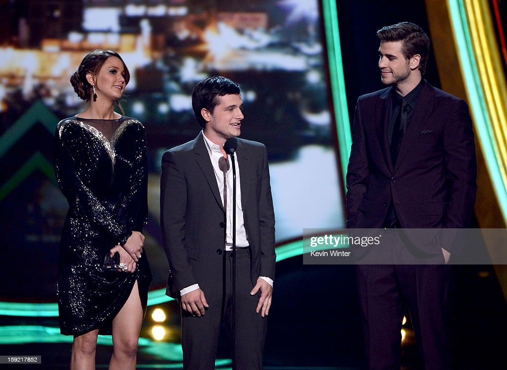 Actors Jennifer Lawrence, Josh Hutcherson, and Liam Hemsworth accept the Favorite Movie award onstage at the 39th Annual People's Choice Awards at Nokia Theatre L.A. Live on January 9, 2013 in Los Angeles, California.