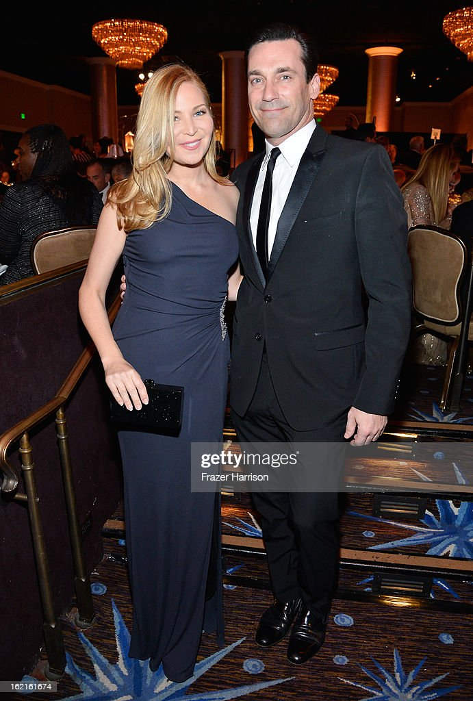 Actors Jennifer Westfeldt (L) and Jon Hamm during the 15th Annual Costume Designers Guild Awards with presenting sponsor Lacoste at The Beverly Hilton Hotel on February 19, 2013 in Beverly Hills, California.