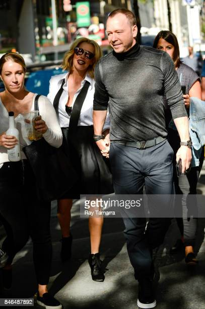 Actors Jenny McCarthy and Donnie Wahlberg enter the 'Today Show' taping at the NBC Rockefeller Center Studios on September 13 2017 in New York City
