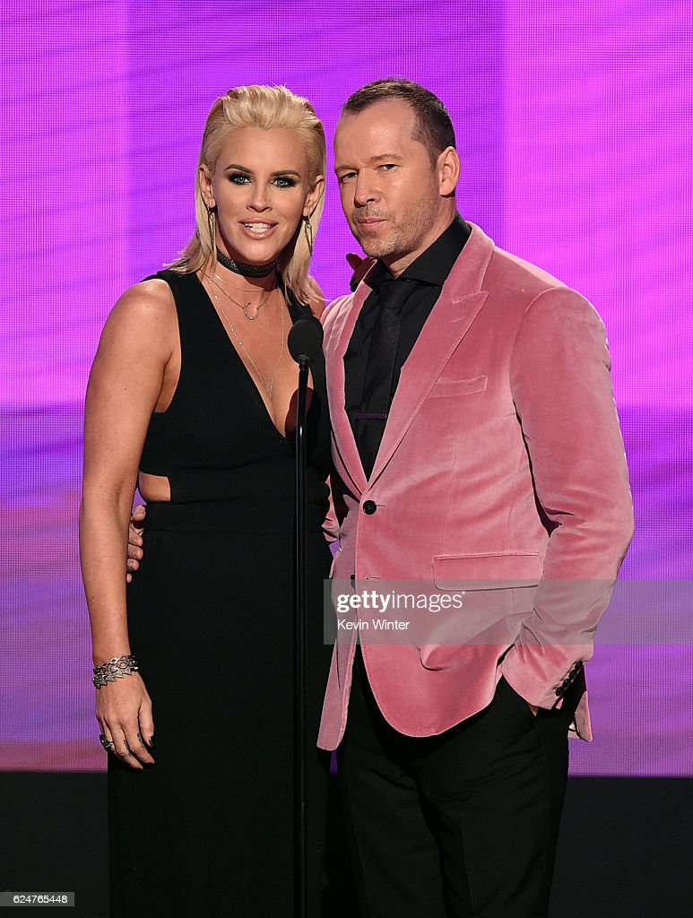 Actors Jenny McCarthy (L) and Donnie Wahlberg present an award onstage during the 2016 American Music Awards at Microsoft Theater on November 20, 2016 in Los Angeles, California.