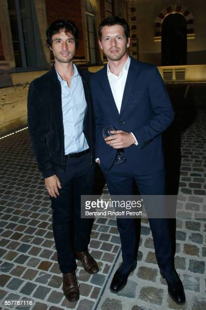 Actors Jeremie Elkaim and Pierre Deladonchamps attend the 'Diner Surrealiste' to celebrate the 241th birthday of 'Maison Louis Roederer' on October 4...