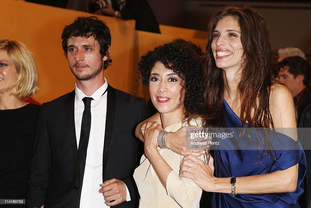 Actors Jeremie Elkaim, Naidra Ayadi and director <a gi-track='captionPersonalityLinkClicked' href=/galleries/search?phrase=Maiwenn+Le+Besco&family=editorial&specificpeople=3961805 ng-click='$event.stopPropagation()'>Maiwenn Le Besco</a> attend the 'Polisse' premiere at the Palais des Festivals during the 64th Cannes Film Festival on May 13, 2011 in Cannes, France.