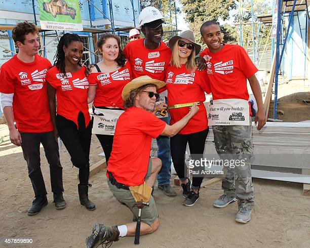 Actors Jeremy Allen White Shanola Hampton Emma Kenney William H Macy Glynn Turman Kristen Bell and Donis Leonard Jr help build homes with 'Habitat...