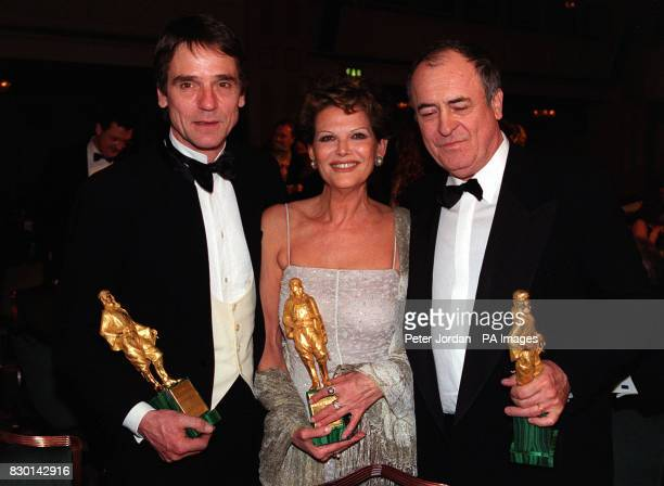 Actors Jeremy Irons and Claudia Cardinale with Director Bernado Bertolucci with their Lifetime Achievement In Cinema awards at the Rudolph Valentino...