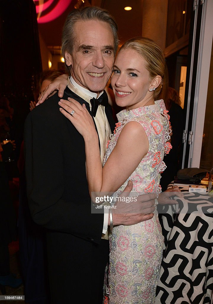Actors Jeremy Irons (L) and Sienna Miller attend HBO's Official Golden Globe Awards After Party held at Circa 55 Restaurant at The Beverly Hilton Hotel on January 13, 2013 in Beverly Hills, California.