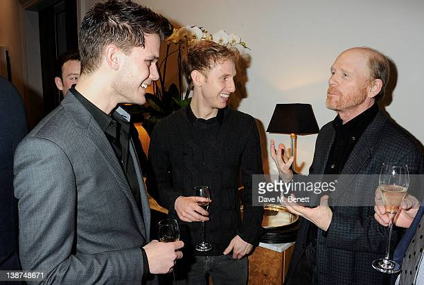 Actors Jeremy Irvine Robert Emms and director Ron Howard attend the Dreamworks PreBAFTA Tea Party in celebration of 'The Help' and 'War Horse' at The...