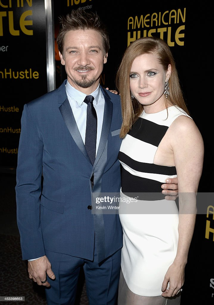 Actors <a gi-track='captionPersonalityLinkClicked' href=/galleries/search?phrase=Jeremy+Renner&family=editorial&specificpeople=708701 ng-click='$event.stopPropagation()'>Jeremy Renner</a> (L) and <a gi-track='captionPersonalityLinkClicked' href=/galleries/search?phrase=Amy+Adams&family=editorial&specificpeople=213938 ng-click='$event.stopPropagation()'>Amy Adams</a> attend Columbia Pictures And Annapurna Pictures' 'American Hustle' Special Screening at Directors Guild Of America on December 3, 2013 in Los Angeles, California.