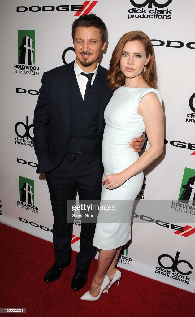 Actors Jeremy Renner and Amy Adams pose in the press room during the 17th Annual Hollywood Film Awards at The Beverly Hilton Hotel on October 21, 2013 in Beverly Hills, California.