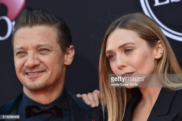 Actors Jeremy Renner and Elizabeth Olsen arrive at the 2017 ESPYS at Microsoft Theater on July 12 2017 in Los Angeles California