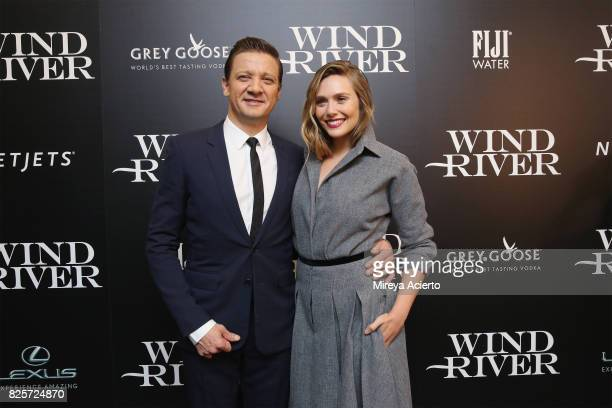 Actors Jeremy Renner and Elizabeth Olsen attend The Weinstein Company with FIJI Grey Goose Lexus and NetJets screening of 'Wind River' at The Museum...