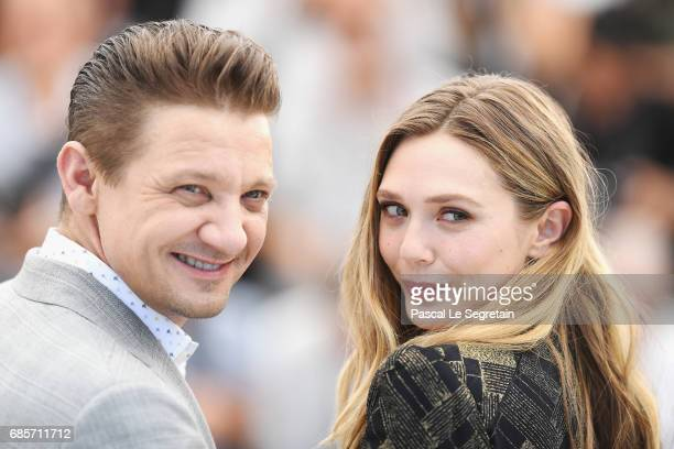 Actors Jeremy Renner and Elizabeth Olsen attend the 'Wind River' photocall during the 70th annual Cannes Film Festival at Palais des Festivals on May...
